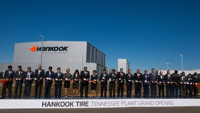 Executives and local leaders cut the ribbon during the Clarksville Hankook plant's grand opening on October 17, 2017.