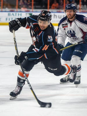 Kansas City Mavericks forward Loren Ulett takes a shot goal during a 2019 game. The left wing, who had 10 goals and eight assists in 55 games for the Mavericks last season, re-signed with the ECHL team Tuesday.