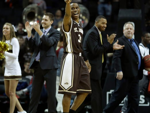 St. Bonaventure's Charlon Kloof celebrates as he leaves the court after St. Bonaventure defeated Saint Louis, 71-68, in the A-10 quarterfinals.