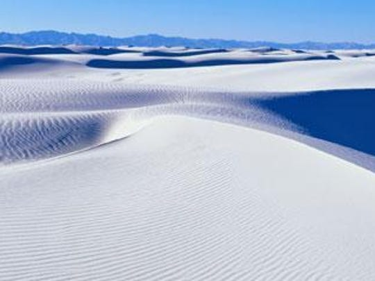 Rising from the heart of the Tularosa Basin is one of the world's great natural wonders - the glistening white sands of New Mexico.