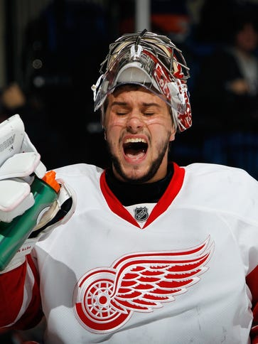Petr Mrazek #34 of the Detroit Red Wings takes a water