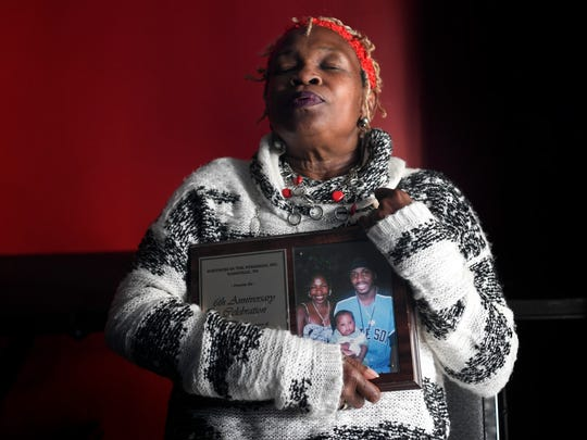 Clemmie Greenlee, founder of Mothers Over Murder, hugs a picture of her son, Roderiquez, who was killed in 2003 in Nashville.