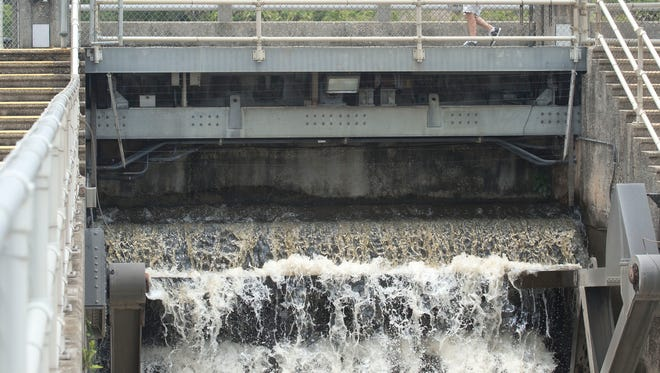 Water from Lake Okeechobee pours through the St. Lucie Lock and Dam near Stuart on June 16, 2016.