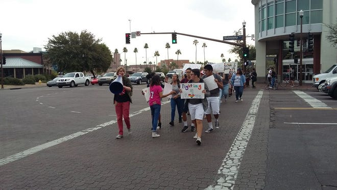 A group of 75 to 80 students from Tempe High School walk down Mill Avenue on Nov. 16, 2016, to protest President-elect Donald Trump's rhetoric.