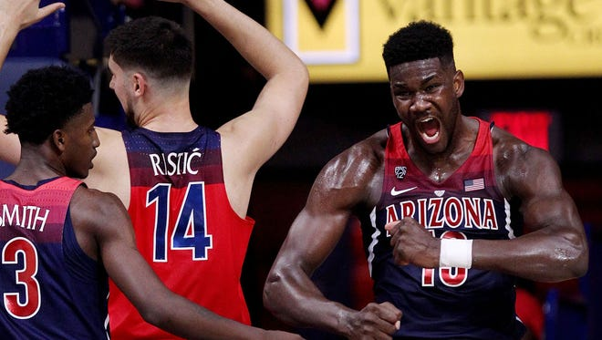 Arizona Wildcats forward Deandre Ayton (13) flexes and roars after an and-one layup during the second half.