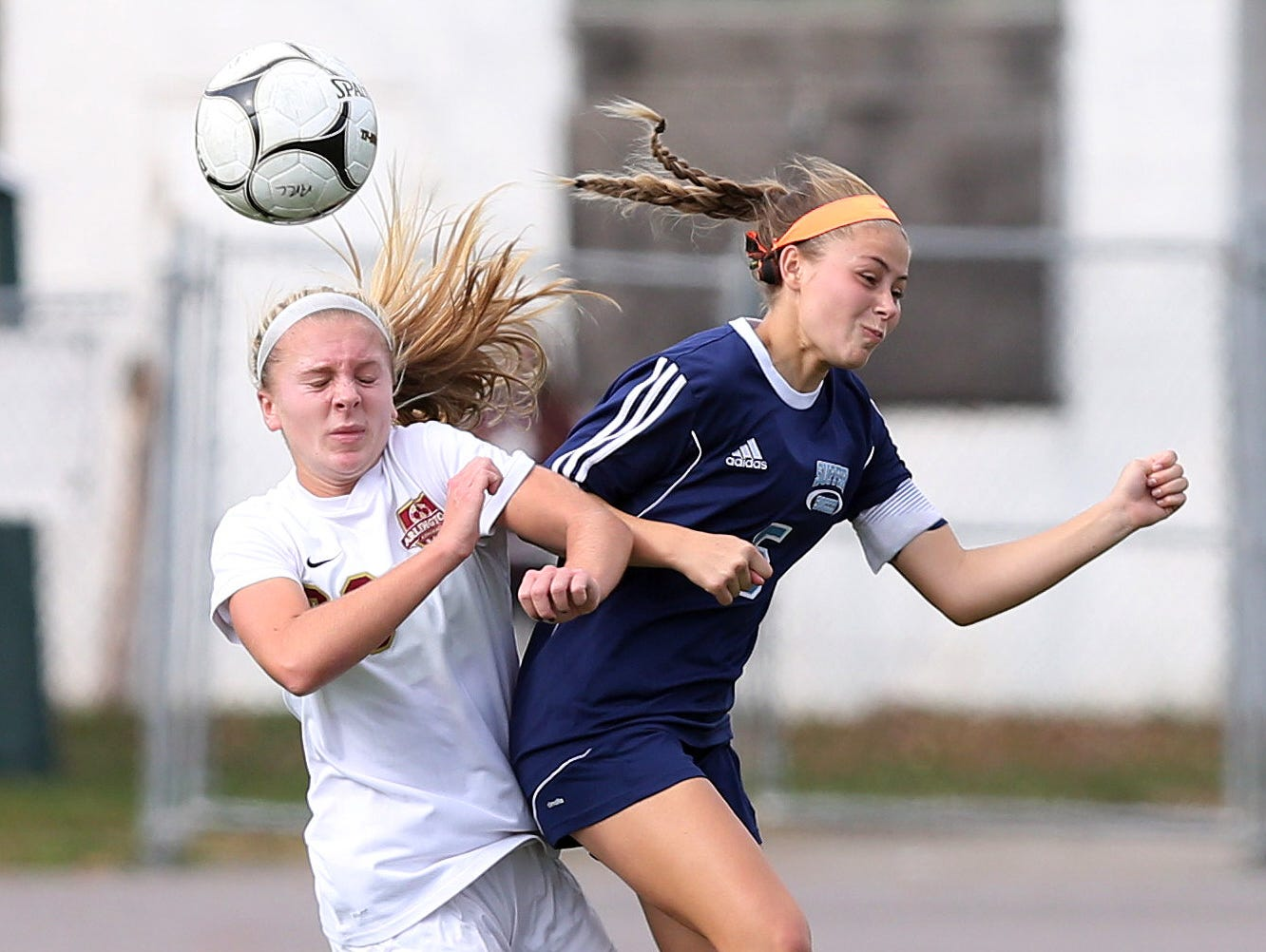 From left, Arlington's Molly Feign (29) and Suffern's Abby Bosco (5) battle for ball control during the girls soccer Section 1 Class AA championship game at Yorktown High School Oct. 30, 2016. Arlington won the game 2-0.