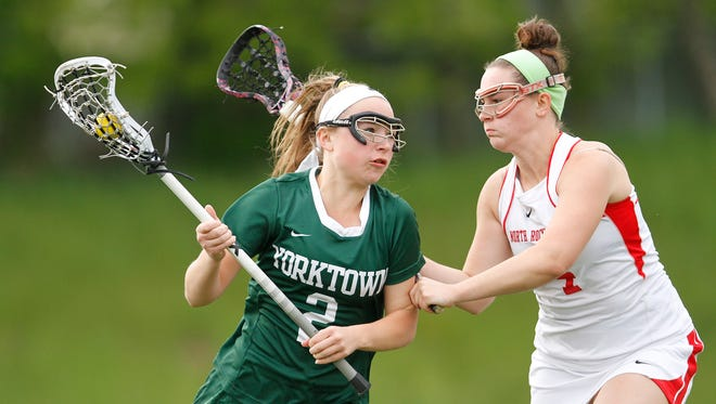 Yorktown's Michelle Seger (2) works the ball as North Rockland's Cayleen Murphy (4) defends during a girls lacrosse game at North Rockland High School in Thiells on Tuesday, May 10, 2016.