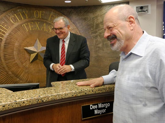 Dee Margo laughs with outgoing Mayor Oscar Leeser on Leeser's last day in office after Margo won the El Paso race for mayor. Leeser did not seek re-election.