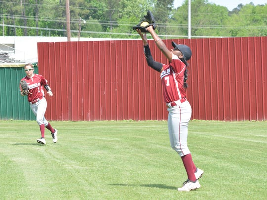 Pineville's Hailee Wilkins (7, right) catches a fly ball during a 2015 game against Calvary.
