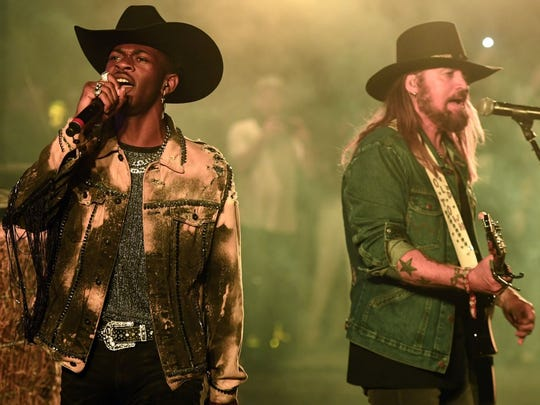 "Lil Nas X, left, and Billy Ray Cyrus teamed up for a hit version of ""Old Town Road."""
