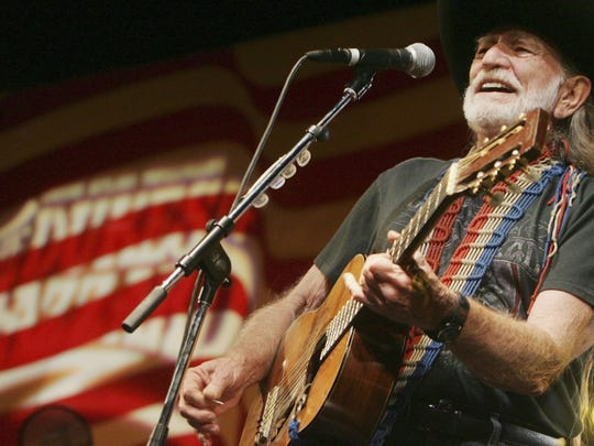 Willie Nelson performs in an undated photo. The country singer's management didn't allow The News-Press to shoot Thursday's show without unacceptable restrictions.