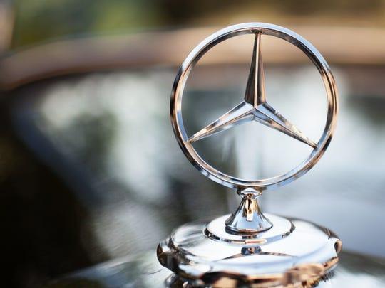 A Mercedes-Benz logo.