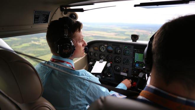 Fox Valley Technical College student pilot Brandon Whitford flies with instructor Justin Heimermann.