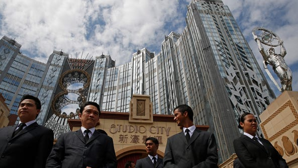 Security guards stand outside a casino in Macau on