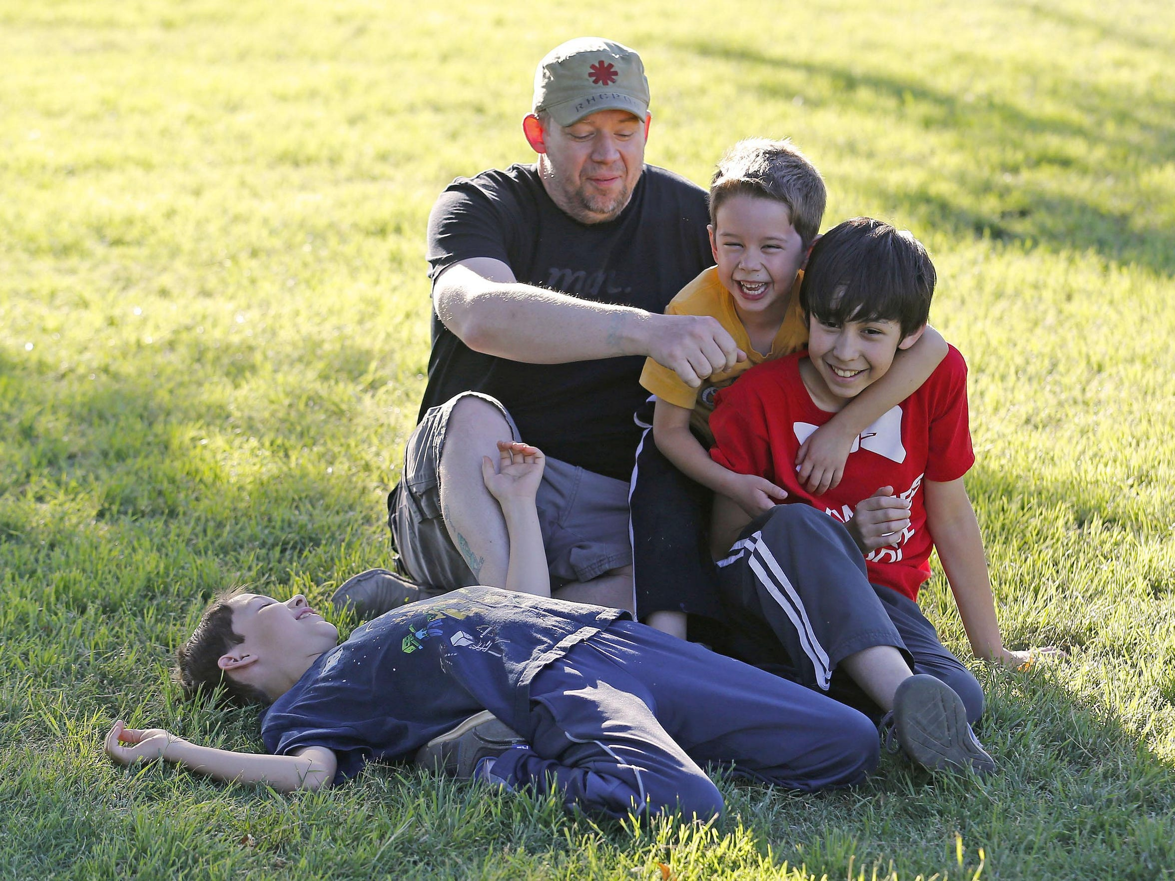 Jason Philo plays with his three boys, Adam  (red shirt),