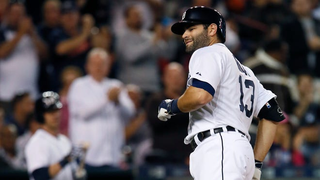 Alex Avila of the Detroit Tigers smiles after hitting a solo home run against the Chicago White Sox on Sept. 21, 2015 in Detroit.