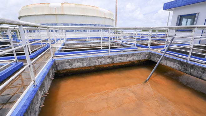 In this file photo, cloudy, murky water sits in a compartment at the Ugum Water Treatment Plant in Talofofo, waiting for the next step in the filtration process.
