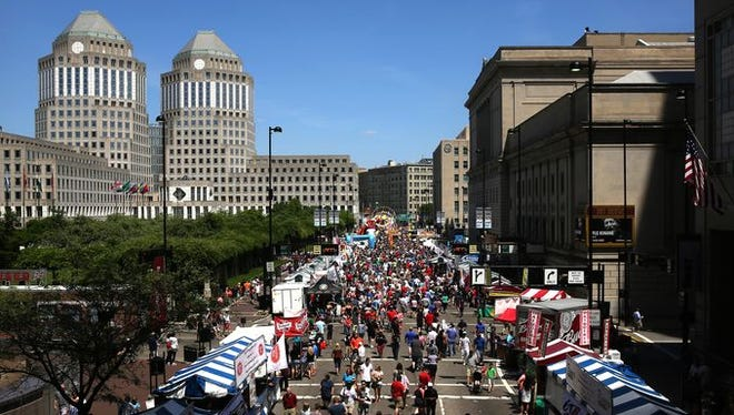 Thousands gather at the Taste of Cincinnati, the annual culinary arts festival that features more than 40 different restaurants on Fifth Street Saturday.