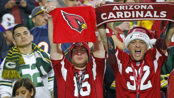 Arizona Cardinals fans celebrate their 38-8 win over the Green Bay Packers in their NFL game Sunday, Dec. 27, 2015 in Glendale.