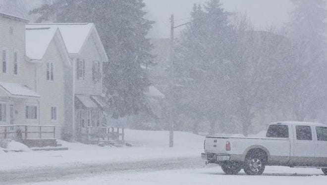 Snow falls in downtown Glenbeulah on Tuesday, coating everything with a mixture of snow and ice pellets.