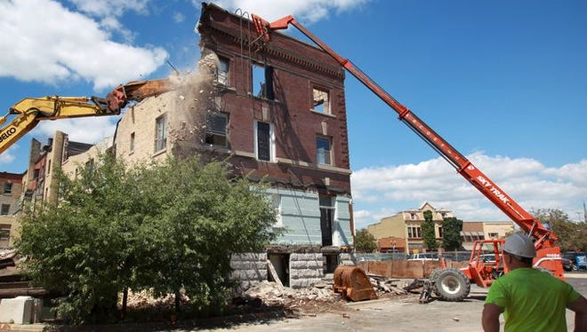 The developers of the former Hotel Menasha site and the bank building next door will present their vision for the sites to the city's Landmarks Commission on Tuesday.
