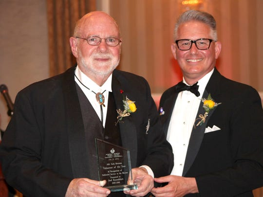 Joel Rosenblatt, left, accepts the Volunteer of the Year award from 2016 York Heart Ball co-chair Steven Alwine, right, on behalf of the York Division of the American Heart Association.