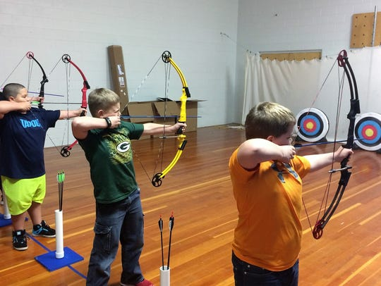 Oconto Middle School students Jacksen Cota, Nate Beekman,