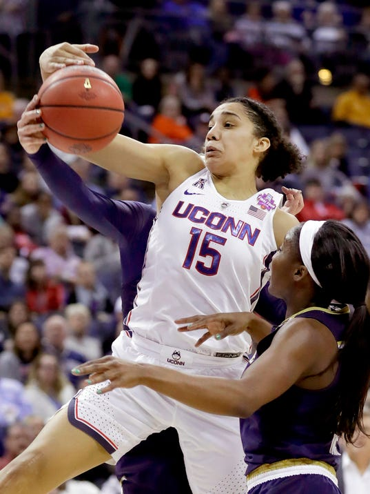 Connecticut's Gabby Williams (15) goes up for a rebound as Notre Dame's Jackie Young watches during the second half in the semifinals of the women's NCAA Final Four college basketball tournament, Friday, March 30, 2018, in Columbus, Ohio. (AP Photo/Ron Schwane)