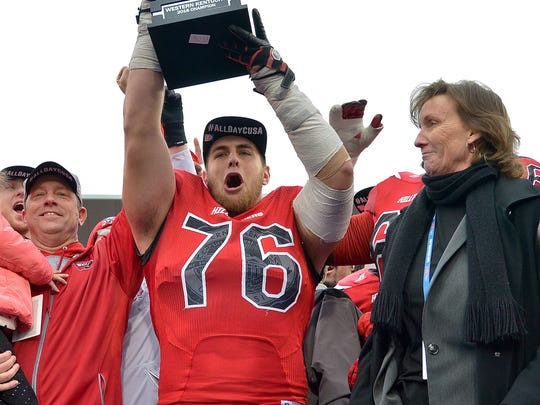 Western Kentucky Hilltoppers head coach Jeff Brohm (left) and Hilltoppers offensive lineman Forrest Lamp (76) celebrate their victory following the CUSA championship game against the Louisiana Tech Bulldogs at Houchens Industries-L.T. Smith Stadium. Western Kentucky won 58-44.