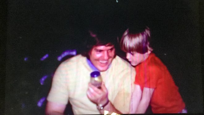 This image of Kevin Foote with his father, Russell, was taken from an old family movie.