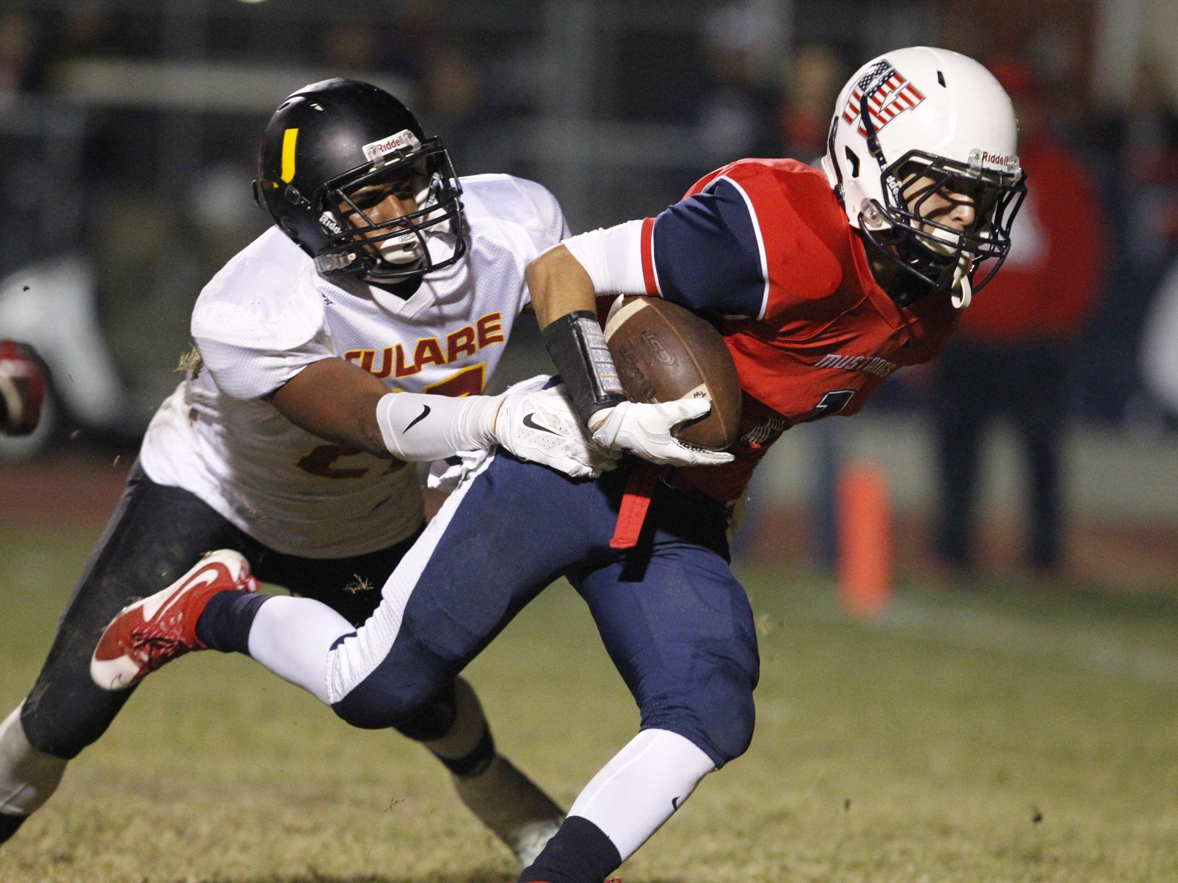 Tulare Union's Xavier Alexander tries to tackle Tulare Western's Josh Portillo during last week's Bell Game. Tulare Western hosts North on Friday in a Division III playoff game. Tulare Union hosts Sunnyside on Nov. 20.