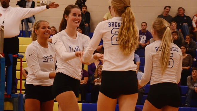 Brentwood's Katie Kemp (24), Kaela Massey (14), Jenny Roy (23) and Anna Wilson (5) celebrate during their 3-0 win over Portland in Thursday's Class AAA sectional