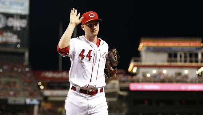 Cincinnati Reds starting pitcher Mike Leake (44) waves to fans as he heads to the dugout in the eighth inning earning the win against the Arizona Diamondbacks at Great American Ball Park.