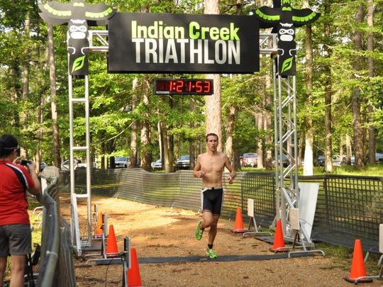 2015 Indian Creek triathletes cross the finish line.