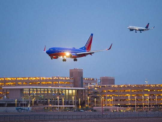 Southwest plane flies into Phoenix Sky Harbor Airport.