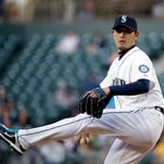 Seattle Mariners starting pitcher Hisashi Iwakuma throws against the Houston Astros in a baseball game Monday, April 20, 2015, in Seattle.