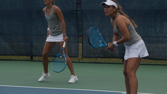 University of West Florida's top women's tennis players, Paula Coyos, left, and doubles partner, Jordana Lujan, face Christian Brother University during tournament play at UWF Friday, April 6, 2018. The UWF duo won the match 8-0, 8-0.