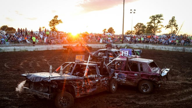 Rob Heuer collides with driver Joe Martin during a stock car division heat at the demolition derby at the Boone County Fair in Sturgeon on Friday, July 20, 2018.