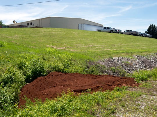 An earthen berm built by the city of Vonore blocks part of a  2,500 foot drainage ditch to prevent more tainted water to flow into the Little Tennessee river from the fire at Protech Metal Finishing facility.