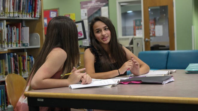 Jazz Jennings, right, and her friend Rachel studying at the library in a scene from the television series I AM JAZZ.  HANDOUT
