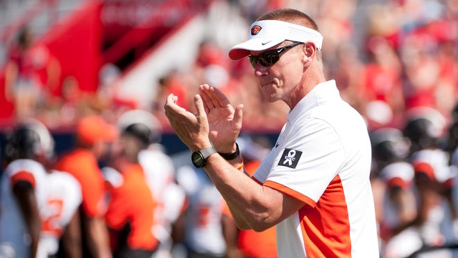 Oct 10, 2015; Tucson, AZ, USA; Oregon State Beavers head coach Gary Andersen walks on the field during warm ups before the game against the Arizona Wildcats at Arizona Stadium. Mandatory Credit: Casey Sapio-USA TODAY Sports
