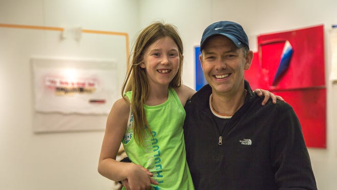 Artist Matthew Boulay (right) and his daughter Claire Boulay stand in the Gretchen Schuette Art Gallery at Chemeketa Community College, where his art inspired by the Iraq War is on exhibit through Feb. 5.