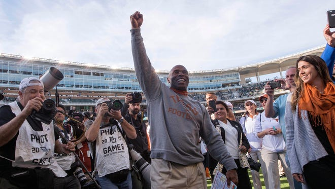 Texas Longhorns head coach Charlie Strong celebrates the win over the Baylor Bears at McLane Stadium.