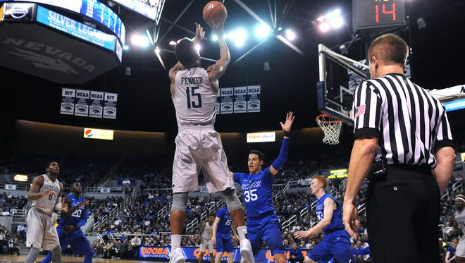 Nevada's D.J. Jenner shoots over Air Force's Hayden Graham during his career game Wednesday.