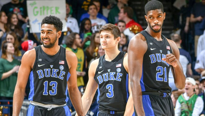Duke Blue Devils guard Matt Jones (13) guard Grayson Allen (3) and forward Amile Jefferson (21) take the court in the first half against the Duke Blue Devils at the Purcell Pavilion. Duke won 84-74.