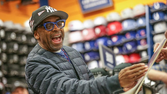 Emmy Award-winning film director Spike Lee, left, signs a autograph for fan Scott Johnson while filming a video project with Lids Sports Group at the Lids store in Circle Center Mall in Indianapolis, March 22, 2017.