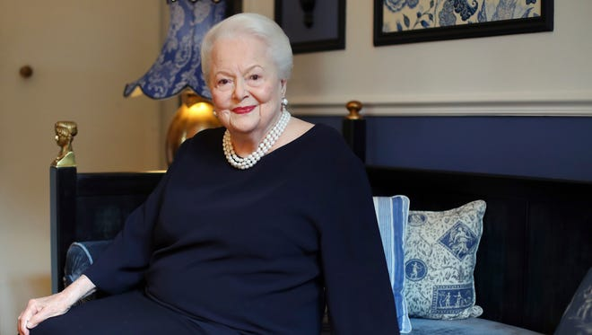 In this June 18, 2016 file photo, U.S. actress Olivia de Havilland poses during an Associated Press interview, in Paris.