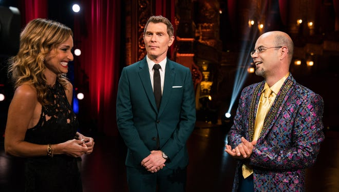 Hosts Giada De Laurentiis and Bobby Flay congratulate winning contestant Jason Smith at the Finale, as seen on Food Network Star, Season 13.