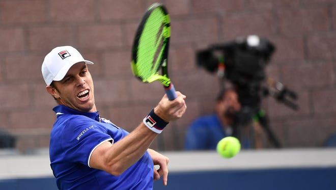 Sam Querrey of Thousand Oaks rips a forehand during his three-set win over France's Gilles Simon in a first-round match Monday at the U.S. Open. Querrey is coming off a semifinal showing at Wimbledon.