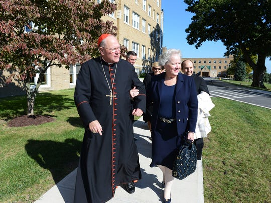 Cardinal Timothy Dolan and Mount Saint Mary College President Anne Carson Daly head into the Dominican Center before the dedication ceremony on Wednesday.
